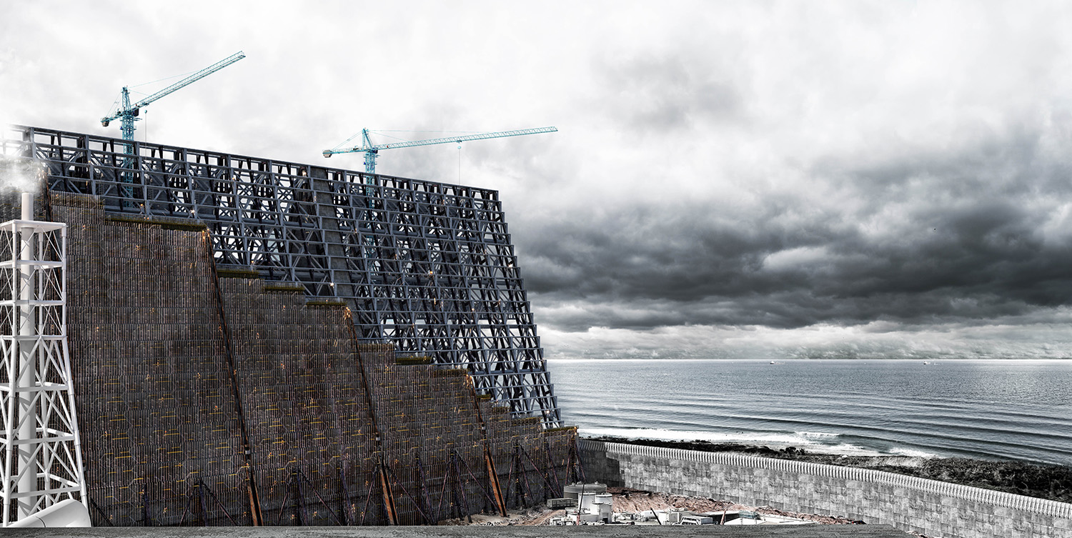 A construction in front of a stormy sky and the sea
