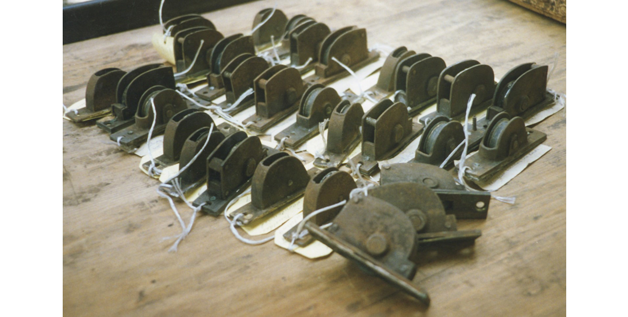 Collection of 29 sash pulleys