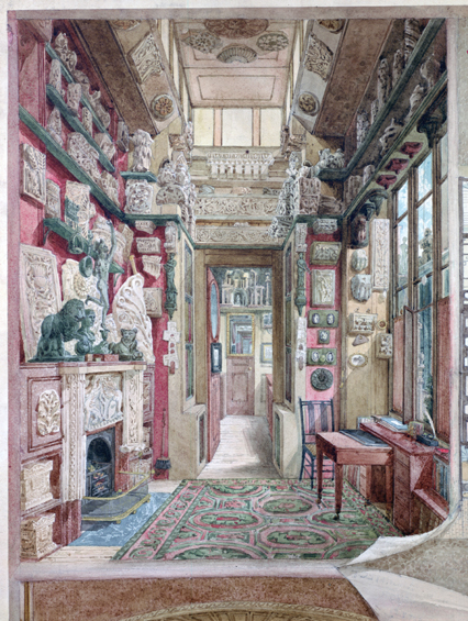 View of the Little Study, 13 Lincoln's Inn Fields. The room is a small room with fragments of architecture hung on the walls densely