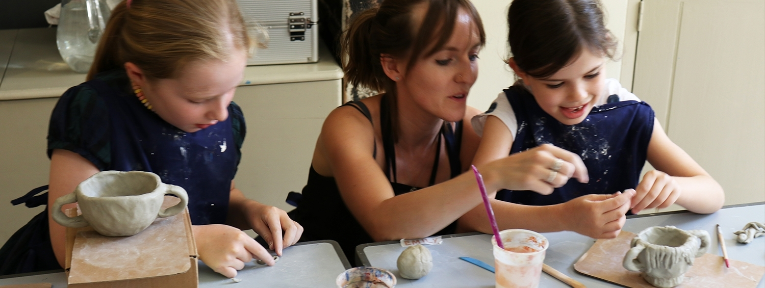 Children create clay sculptures at a family workshop at Sir John Soane's Museum