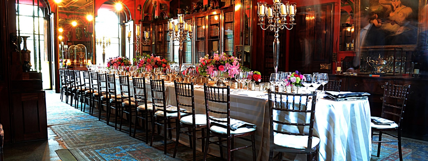 Photograph of a dinner table set up in the Museum's Library Dining Room for a private event