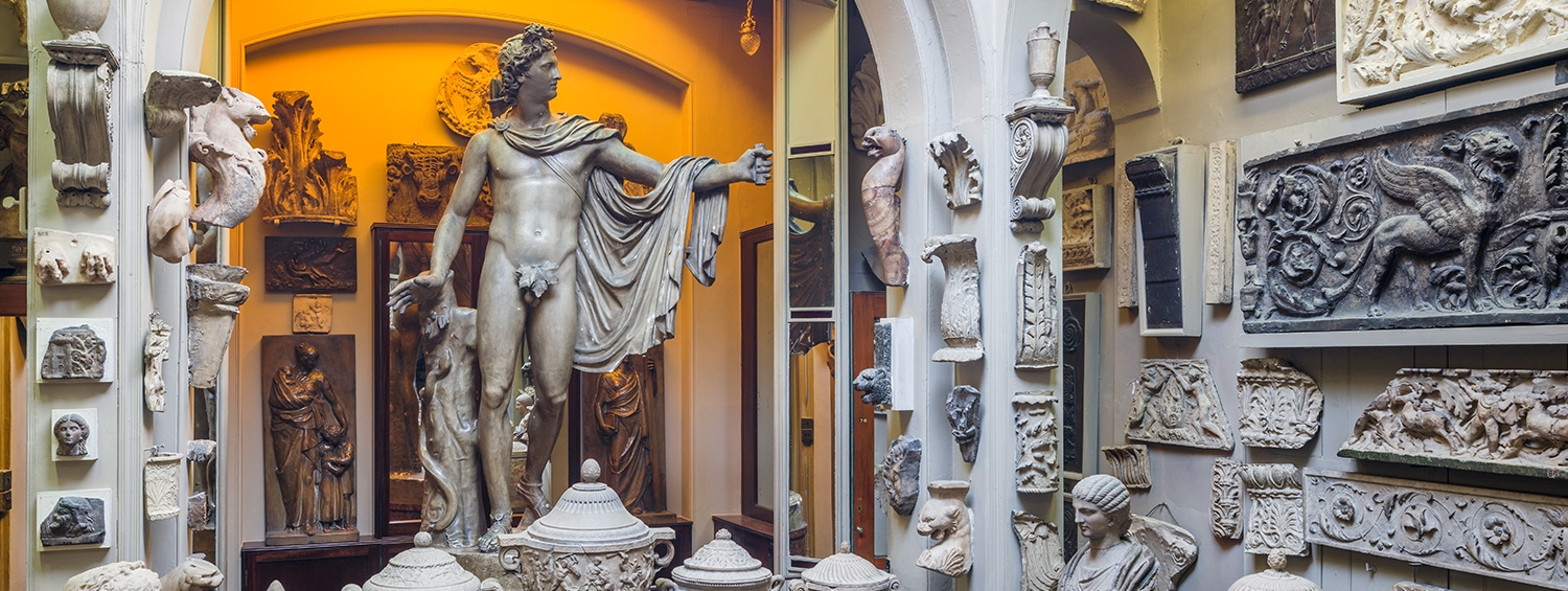 The Dome Area of Sir John Soane's Museum, a space with statues lit by tinted windows