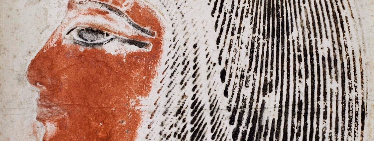 A drawing by Giovanni Belzoni of an Egyptian wall painting of a figure. This detail only shows the face, with its red face.