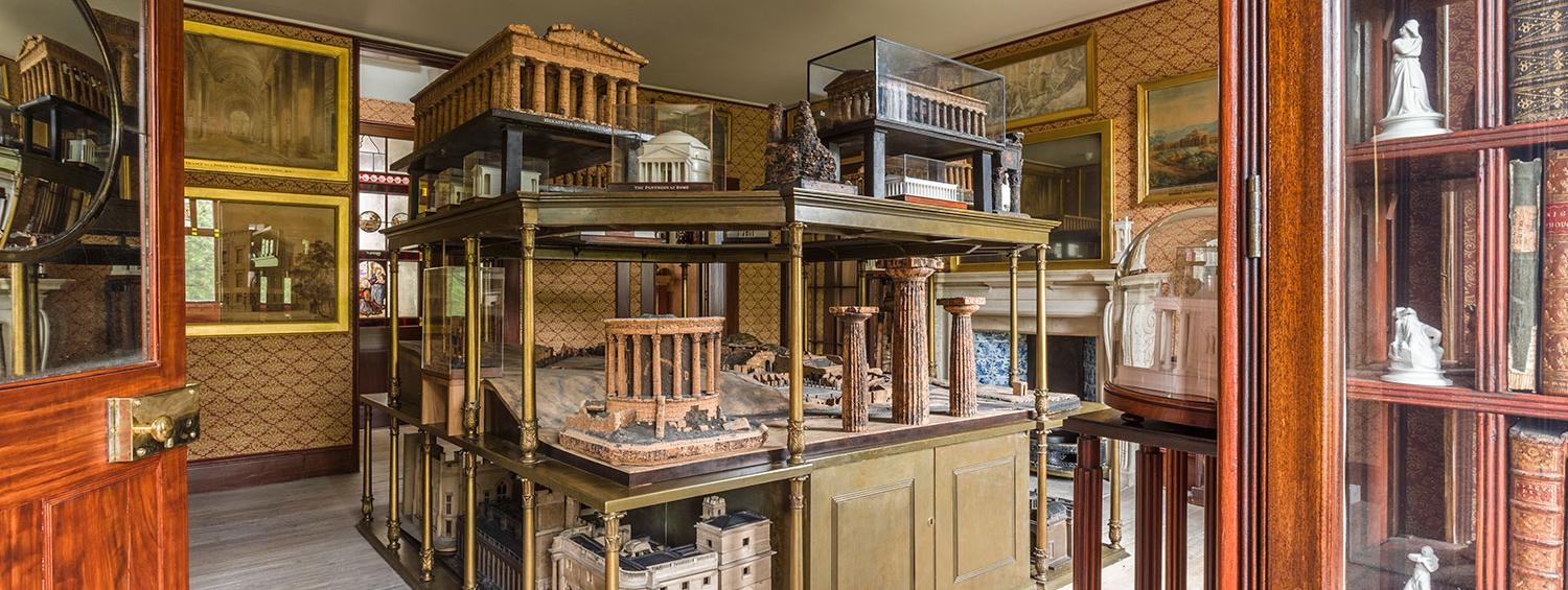 Photograph of the Model Room in the private apartments of Sir John Soane's Museum showing one corner of the three-tiered model stand with the collections of architectural models displayed