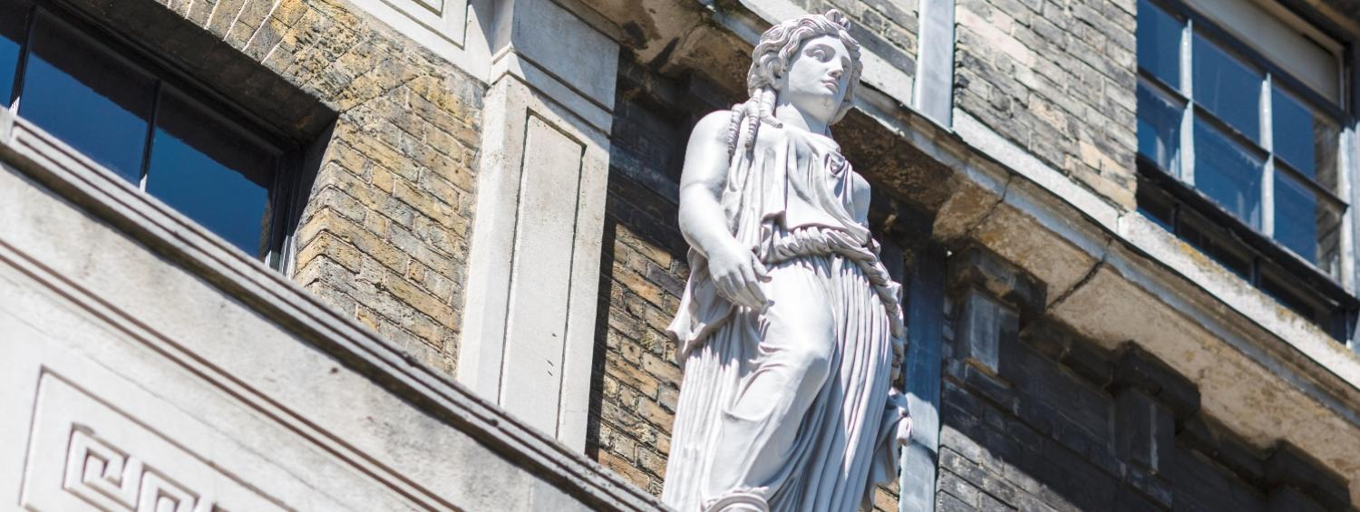 The façade of the Museum with a close up on one of the Caryatids outside a second floor window