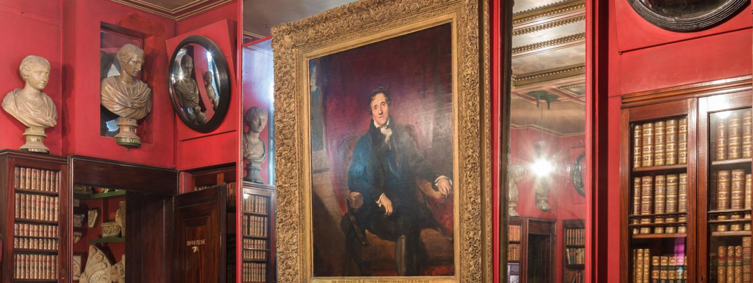 Photograph of the Lawrence portrait of Soane hanging in the Library Dining Room surrounded by mirrors