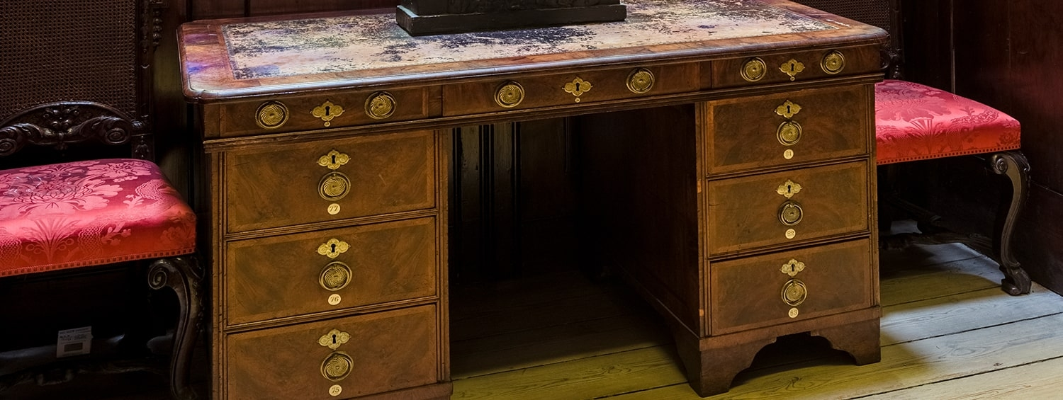 A desk in the Soane Museum made of walnut wood with fine details