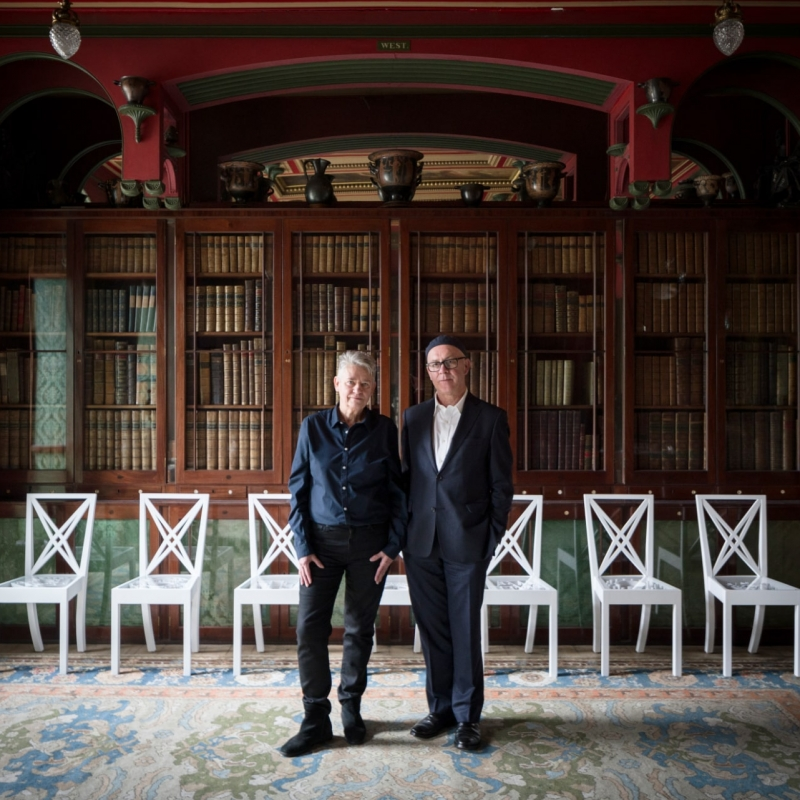 Photograph of artists Langlands and Bell in front of their artwork, installed in the Library of the Soane Museum.
