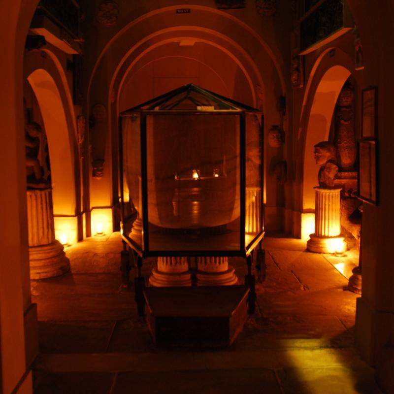 The sarcophagus of King Seti I lit by candlelight in the Soane Museum