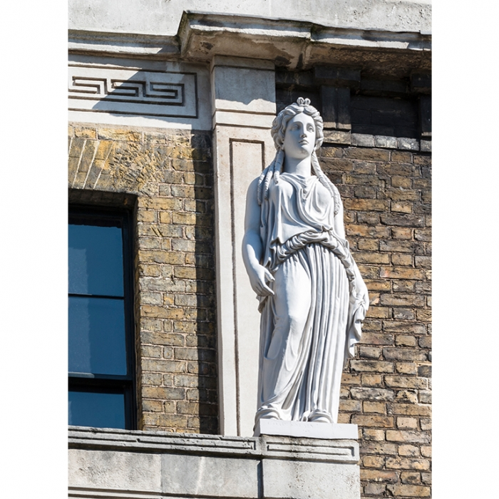 A statue, based on the Greek 'Caryatids' in Athens, high on the facade of the Soane Museum