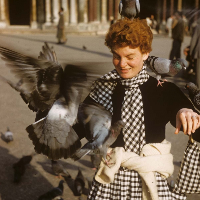 Denise Scott Brown in St Mark's Square getting swarmed by pigeons