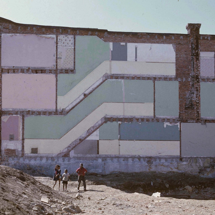 A terrace with the end building demolished, leaving the wallpaper of the destroyed building visible