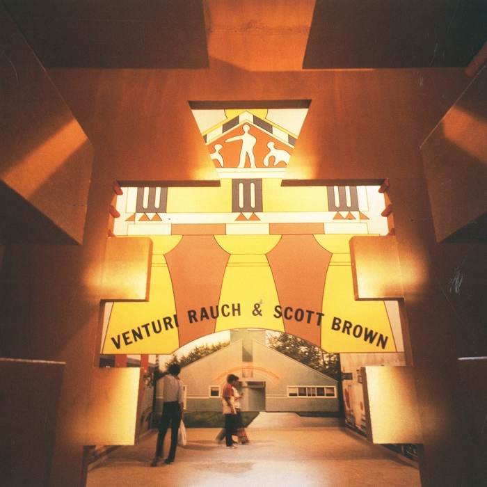 Photo of Venturi Scott Brown's facade at the first Venice Architecture Biennale, an orange and yellow postmodern structure with classical elements