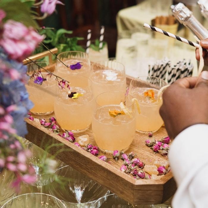 Photograph of cocktails being served at a drinks reception at the Soane