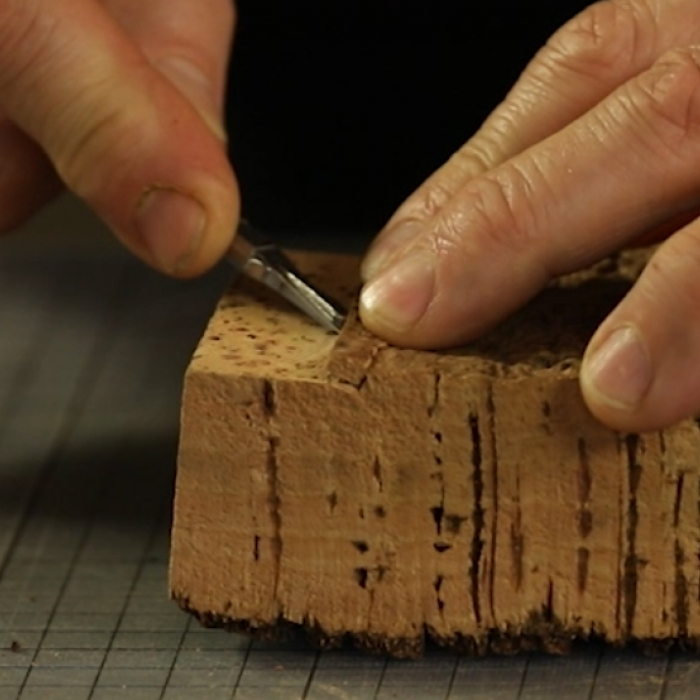 Cutting into a block of cork