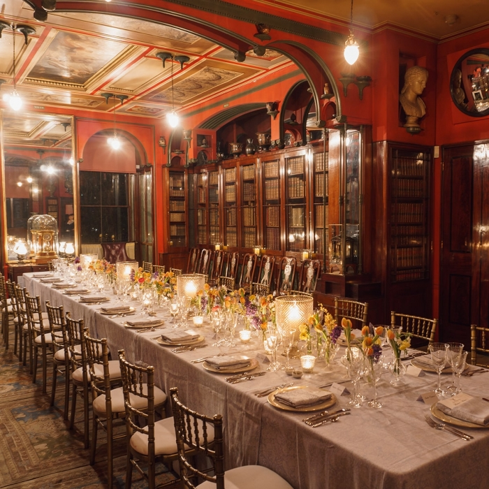 A floral dinner table layout at an event at the Soane