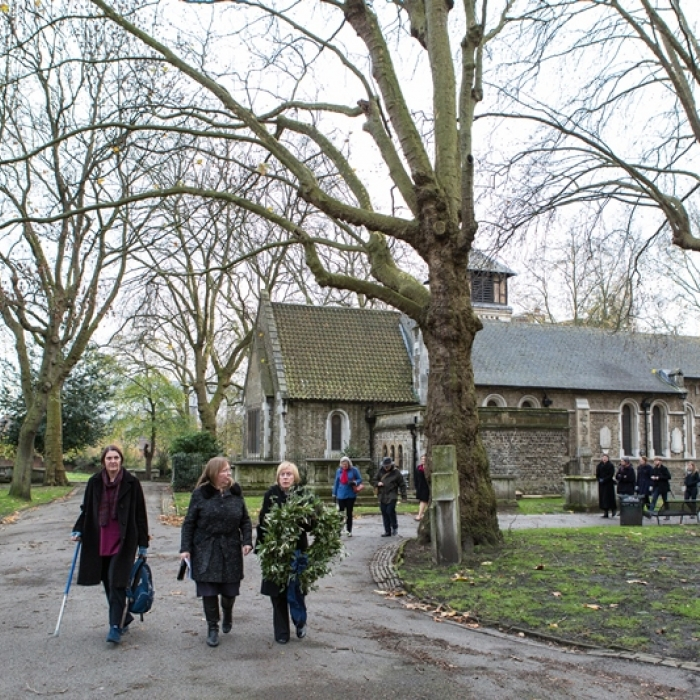 Soane Museum staff carrying the wreath for Eliza Soane at Old St Pancras Churchyard