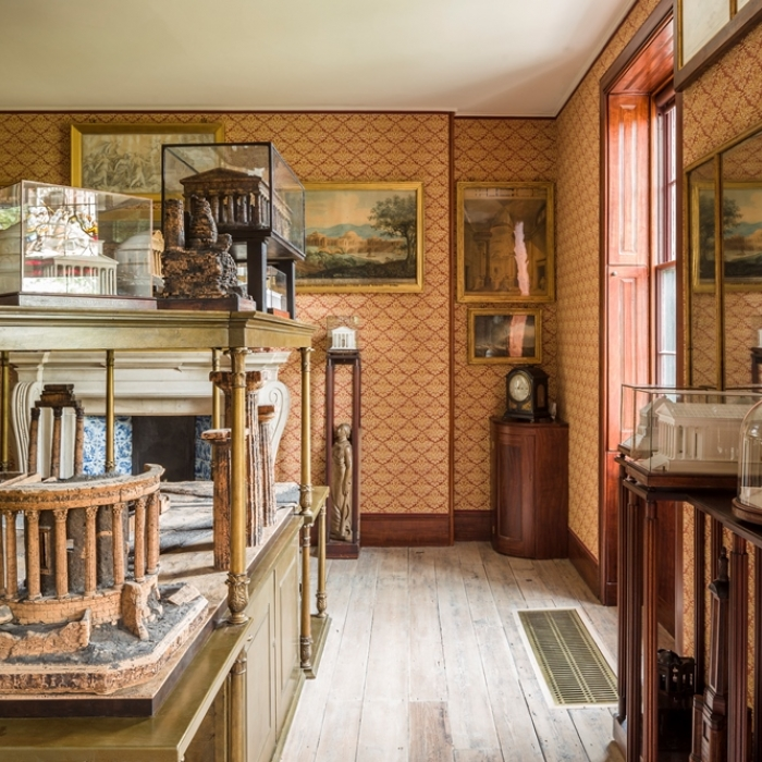Photograph of Soane's Model Room with its stands packed with architectural models in cork and plaster of paris