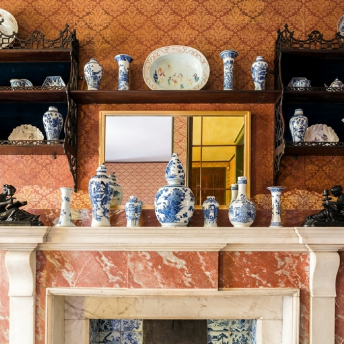 Photograph of the fireplace in Soane's bathroom and his collection of china displayed above it