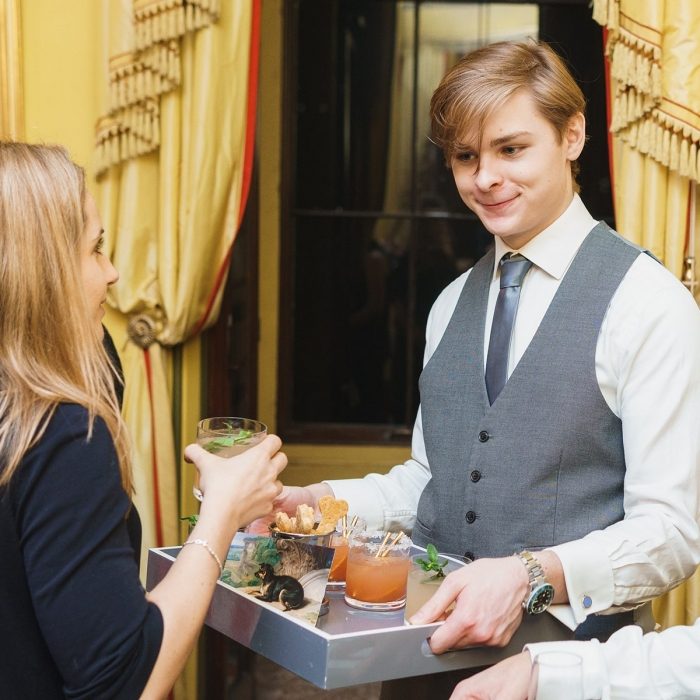 Staff serving drinks in the South Drawing Room
