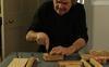 Dieter Coellen cutting a block of cork