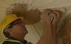 Neil England sticking up a plaster ceiling
