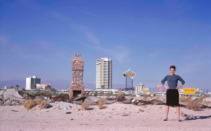 Photograph of Denise Scott Brown standing in front of the Las Vegas strip
