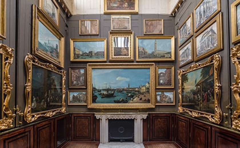 A photograph of the Picture Room at Sir John Soane's Museum, with Canaletto's Riva Degli Schiavoni at present