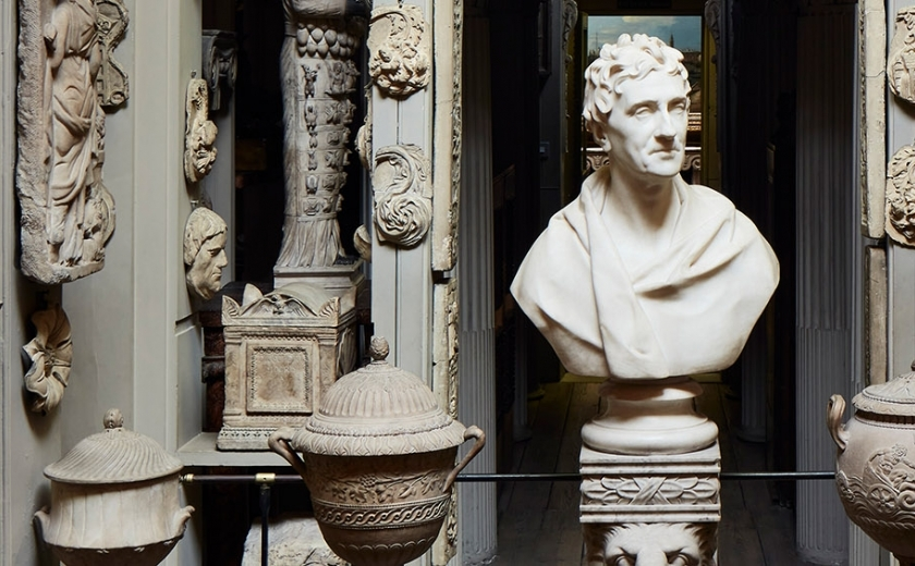 The bust of Sir John Soane in the Dome Area surrounded by fragments and casts of ancient sculpture