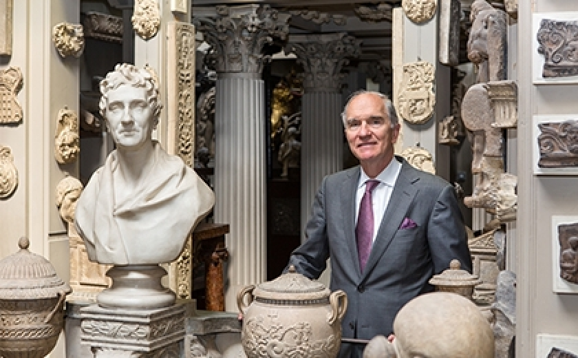 Bruce Boucher in the Dome area of the Museum next to the bust of Sir John Soane