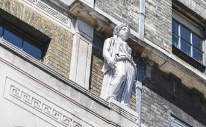 Photograph of the façade of the Museum with a close up on one of the Caryatids outside a second floor window