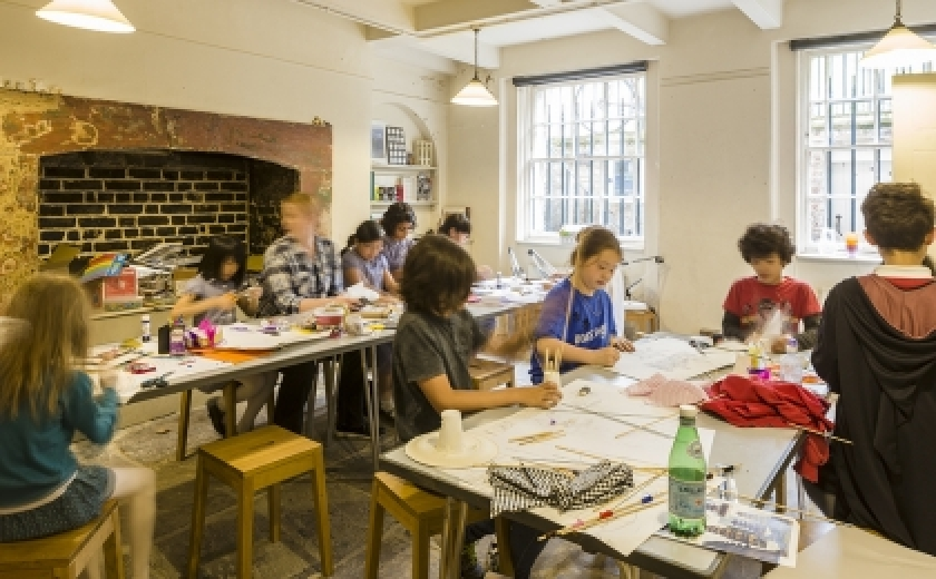 Children making things at a workshop in the Soane art room