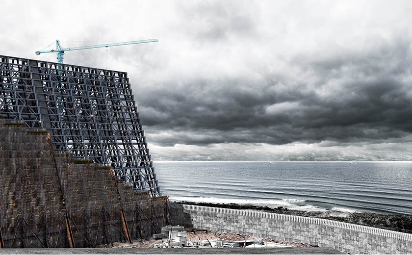 A digital drawing showing a building and cranes by the sea with a stormy sky