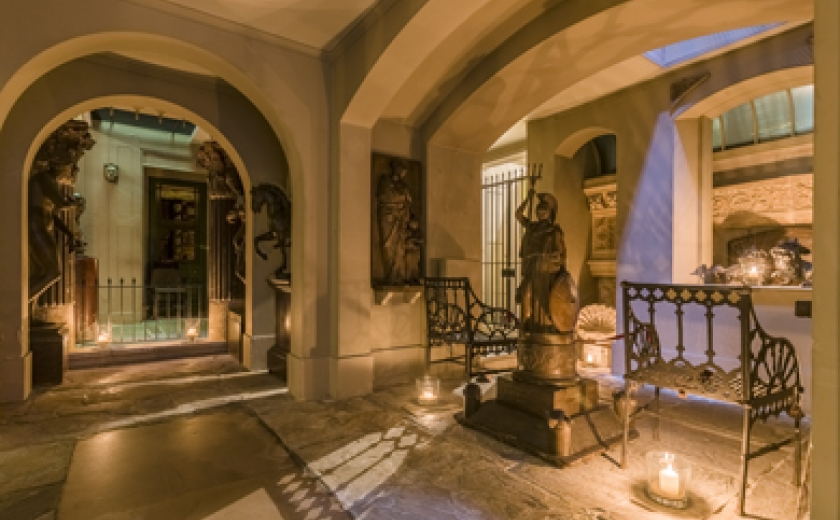 An evening opening at the Soane with the Museum's Egyptian Crypt lit by candlelight