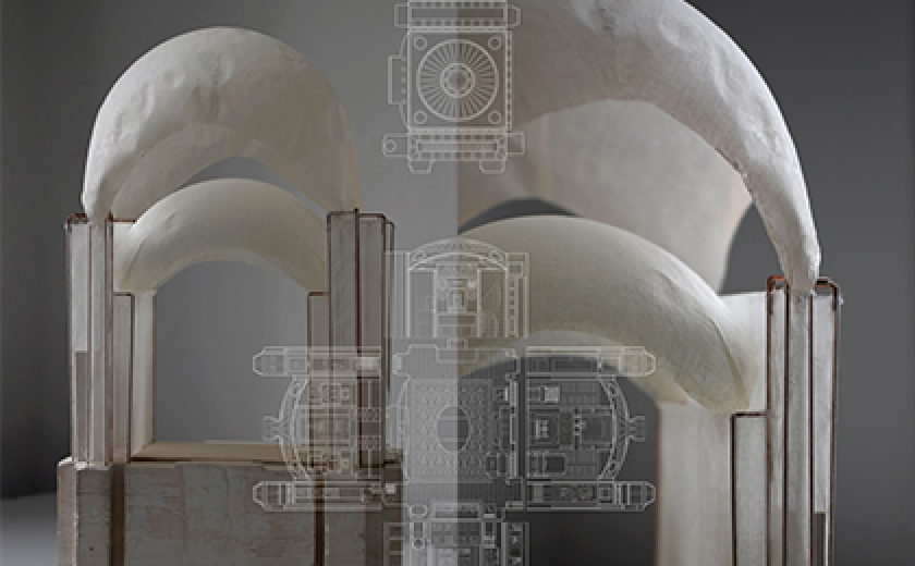 Detail of the architectural work that will be visible in the exhibition. A photo of constructed dome models with drawings superimposed over.