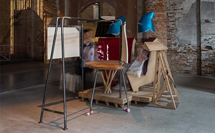 Installation photograph of proposal B by Salter + Collingridge at the Venice Biennale. The artwork is a chair like construction and people are interacting with the object.