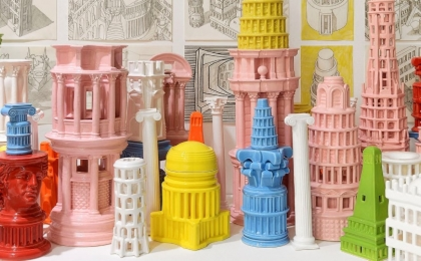 A row of densely packed and vibrantly coloured models of classical architecture by Adam Nathaniel Furman