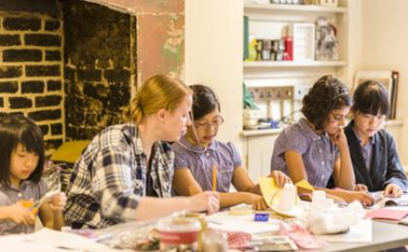 Photograph of children at Sir John Soane's Museum making their own artwork in one of our learning workshops