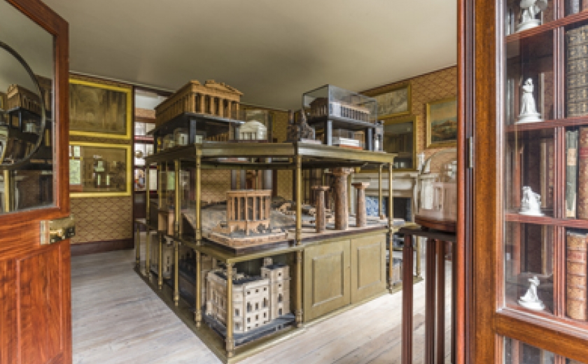 Photograph of the Model Room in Soane's private apartments showing one corner of the three-tiered model stand with the collections of architectural models displayed