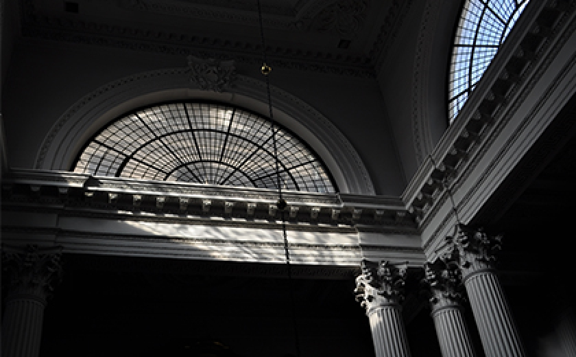 Light falling across classical architectural details