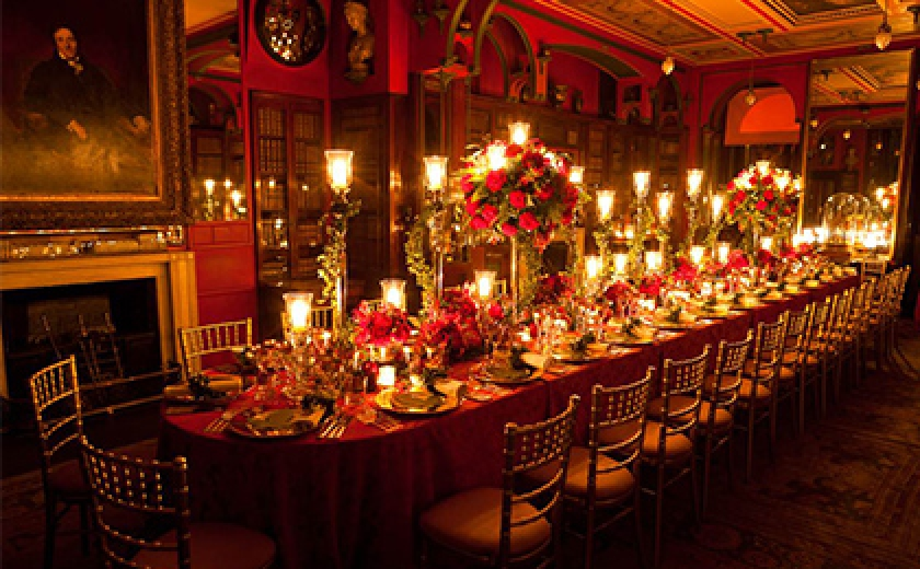 Photograph of a dinner table in the Library Dining Room of Sir John Soane's Museum, laid for an event