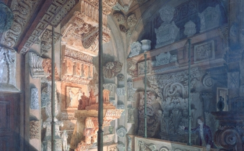 Watercolour by Joseph Michael Gandy showing interior view of the Dome at Sir John Soanes Museum, 13 Lincolns Inn Fields, London, 1813. The image shows the many sculptures and artefacts of the space in blue shadow, being lit ominously from below by an orange light.